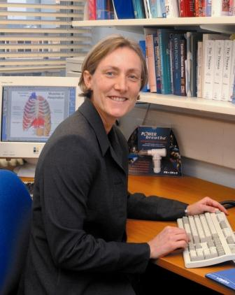 Prof Alison McConnell sat at her desk