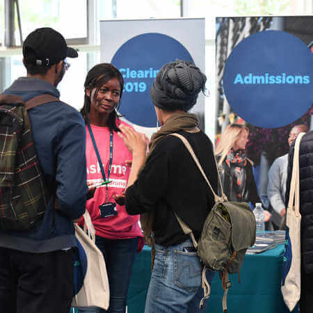 Prospective students talking to admissions adviser during Open Day