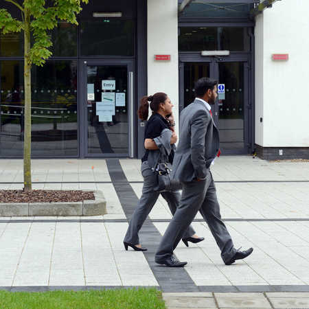 two students walking past business centre