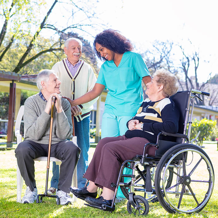 Rehabilitation clinic with elderly people and nurse