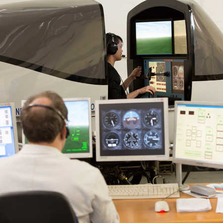 aerospace student testing flight simulator