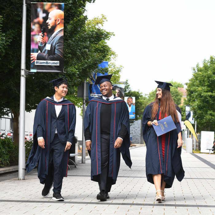 students walking on campus on graduation day