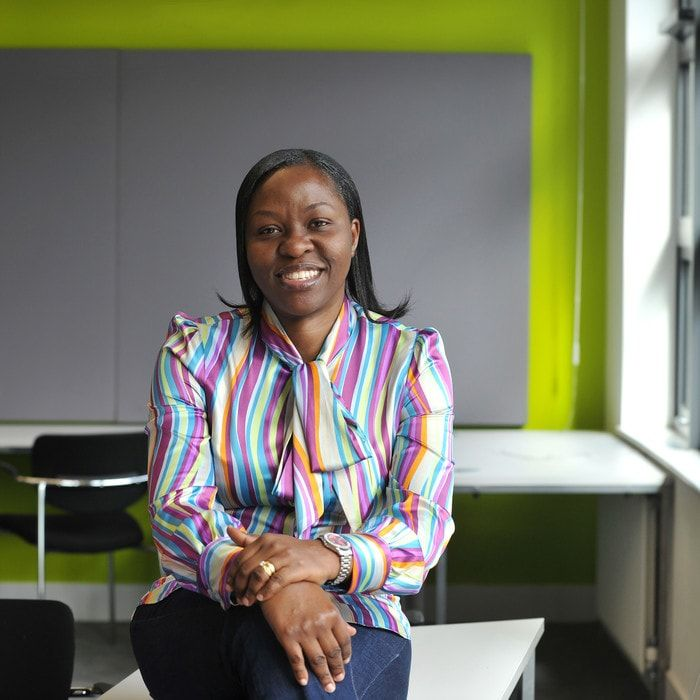 Brunel-Business-School-PhD-student-in bright-stripy-shirt-smiling