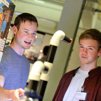 Two students looking at a Design research project