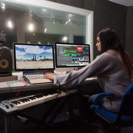 digital media student testing equipment in sound studio