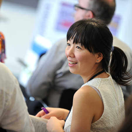 A woman laughs during a conference at the Brunel Macroeconomics research centre