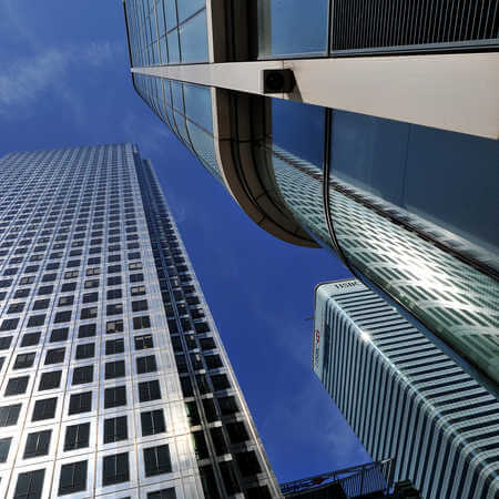 Photo looking up at skyscrapers situated in the economic and financial capital of the UK London