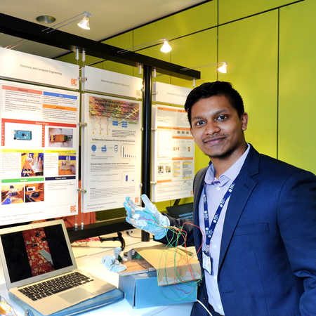 electronic and electrical engineering student presenting project at Brunel Engineers show