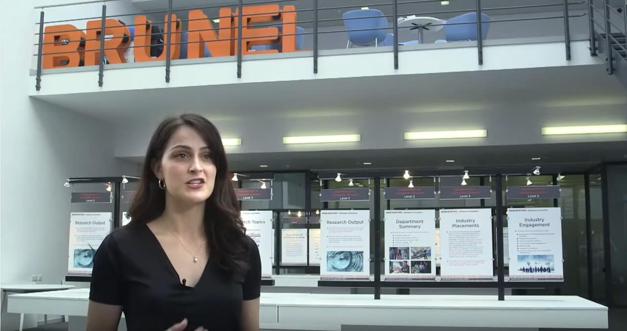 female student in front of a Brunel sign(1)