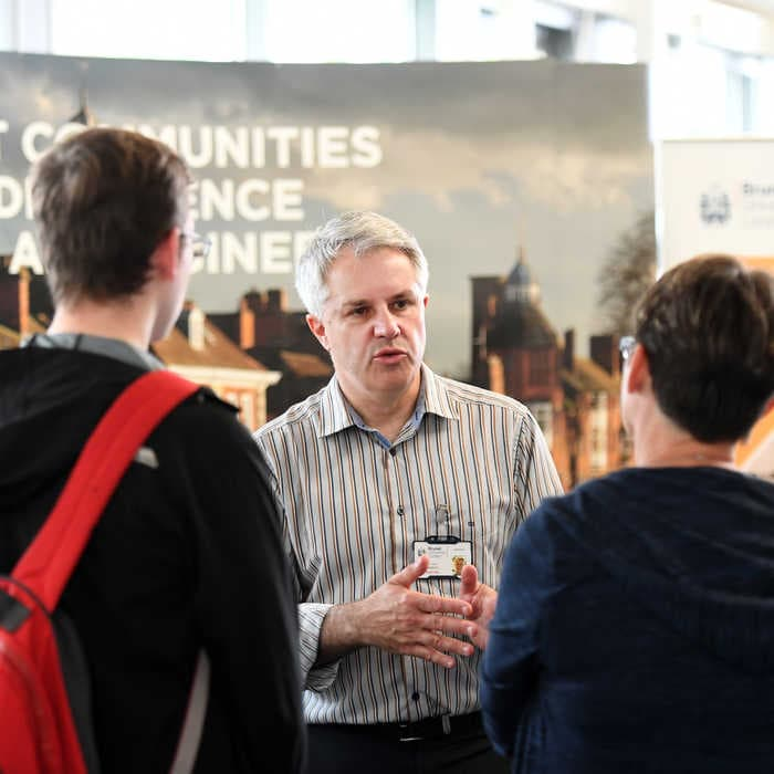 Flood and Coastal Engineering academic welcoming students at an Open Day