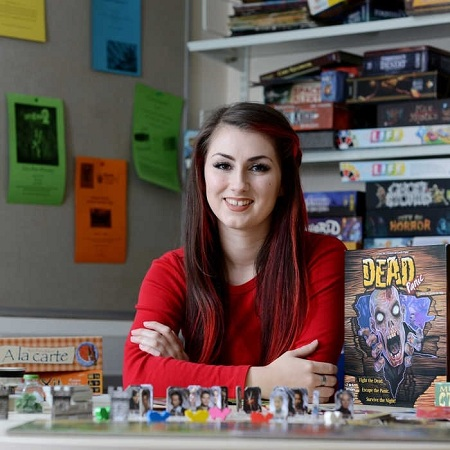 a-female-games-design-student-sitting-amongst-board-games