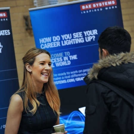 a-student-at-a-careers-fair-talking-to-an-advisor