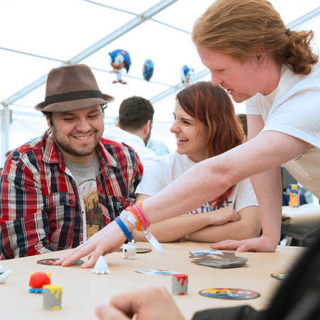 games-design-three-students-at-Brunel-Festival-looking-at-a-board-game