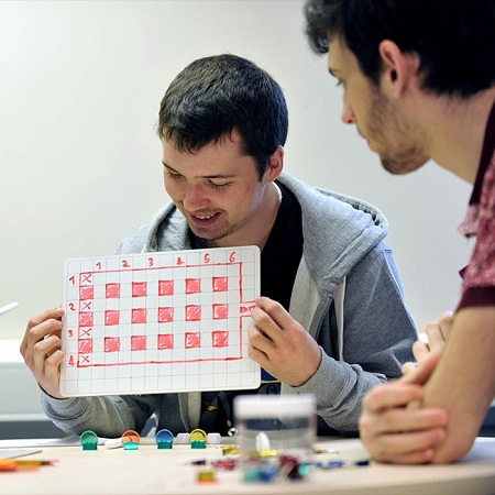 two-male-games-design-students-with-a-prototype-board-game