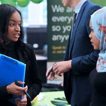 two-women-talking-at-a-careers-fair