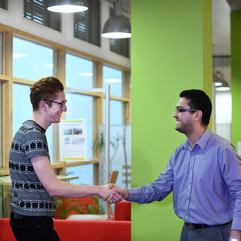 A student meets the Global Challenges pathway leader for his module component op