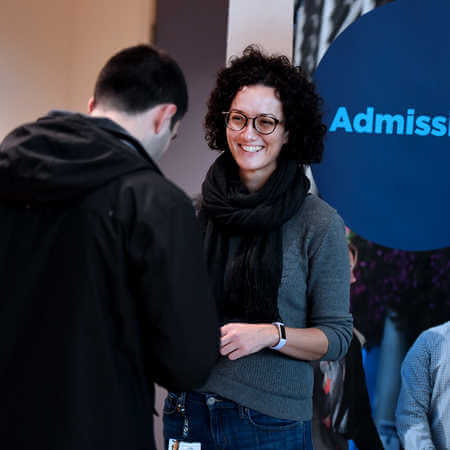 Admissions staff talking to applicant at open day