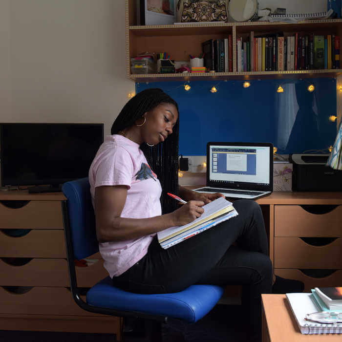 Female student studying in her brunels on campus accommodation