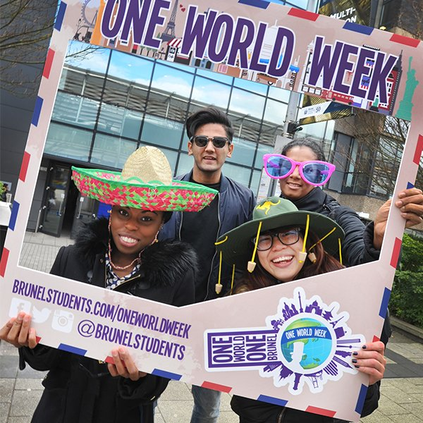 four international celebrating one world week at with a fun sign