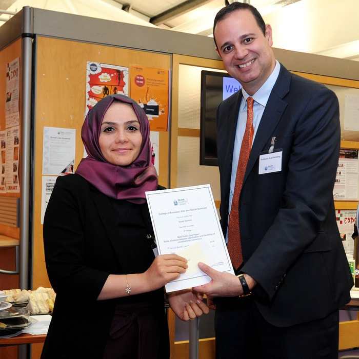 Head of Brunel Law School Arad Reisberg presenting a student with a certificate