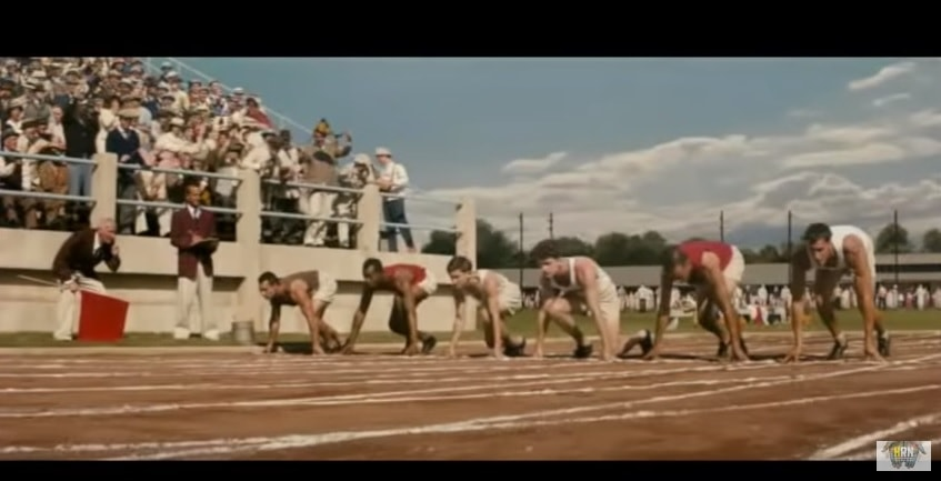 Runners lining up at the start line in the film Race