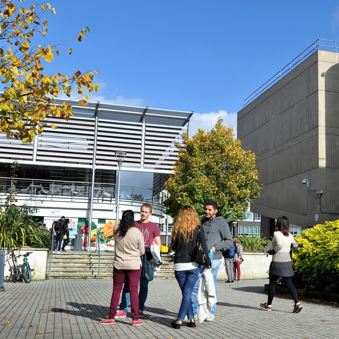 Students in the Brunel campus outside the Hamilton building