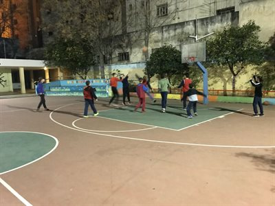 Students playing basketball with refugees in Athens