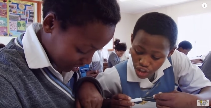 Two girls in school in the Lost Girls of South Africa film