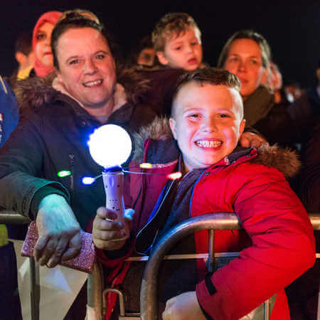 Family smiling at Brunel's firework display