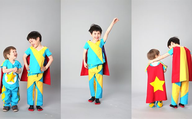 image of Children fly through surgery in new superhero gowns