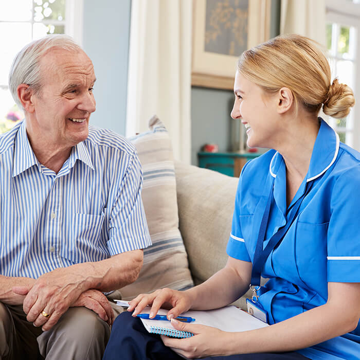 healthcare professional talking to elderly patient