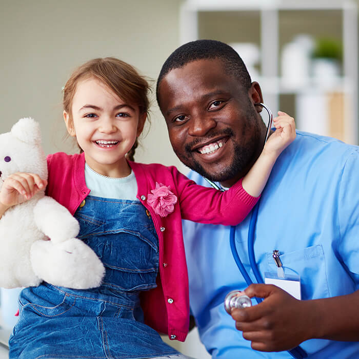 male nurse and small child in examination room