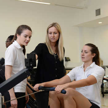 female-students-practicing-rowing-at-physiotherapy-gym-at-brunel-university-london