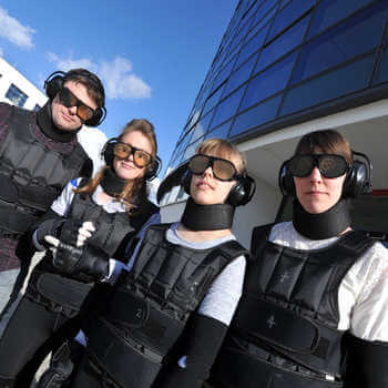 four-physiotherapy-students-in-ageing-simulation-suits-in-front-of-a-building-at-brunel-university-london