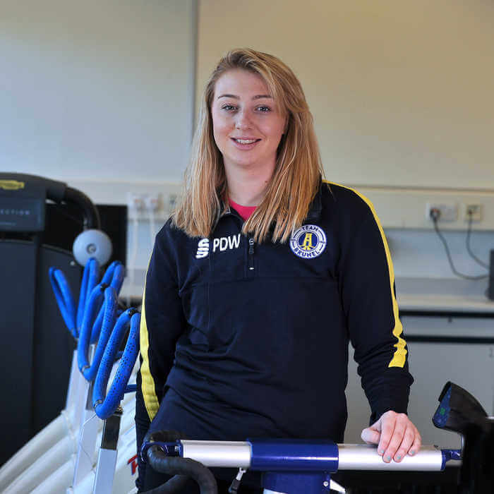 portrait of student in a Sport Health and Exercise Sciences laboratory 4