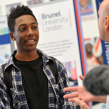 Prospective student talking to a academic at Brunel University Open Day