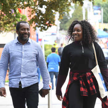Parents of prospective students walking across campus during a Open Day