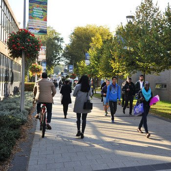 Students walking to lectures on Brunel campus