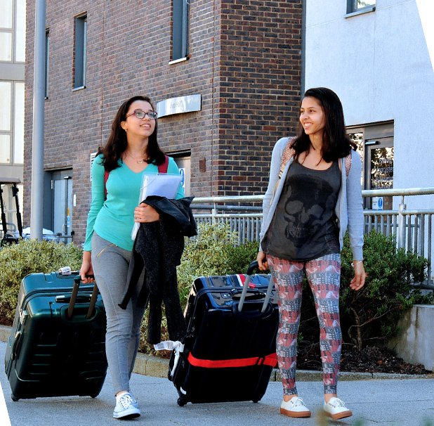 Two students moving into their accommodation